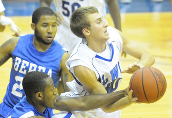 Chase Cox, right, scored four crucial points in the first half to help push Lindsey Wilson past Pikeville. <i>File photo.</i>