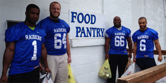 Rome Cotton (left to right), Jon Smith, Corrion Cooper and Chris Dobbins delivered the canned goods to the food pantry.