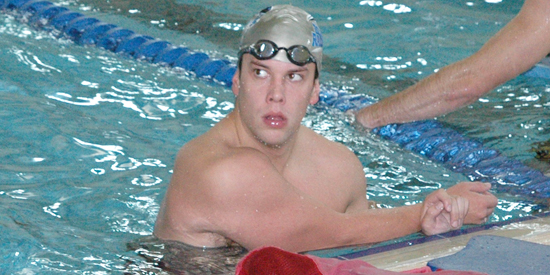 Corey Hall swam a lifetime best 51.83 seconds in the 100-yard butterfly on Friday night.