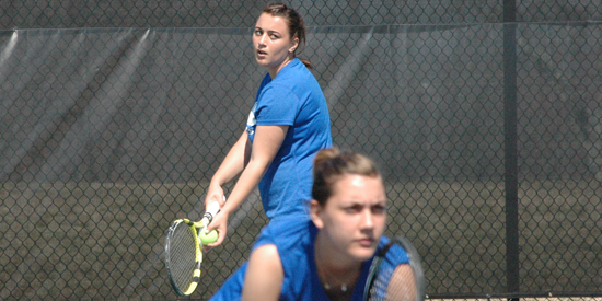 Slavica Milanovic (serving) won at singles and doubles today