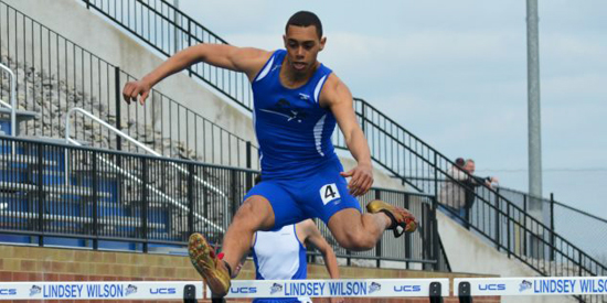 Tylor Pinkard competes in a hurdle event for Lindsey Wilson.