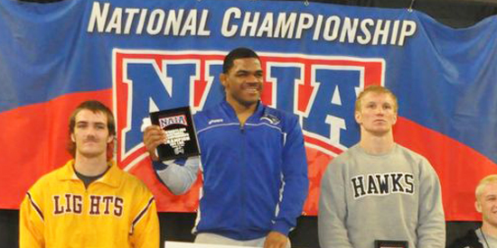 Jameel Bryant, center, is the 2013 NAIA Wrestling National Champion at 184 pounds.