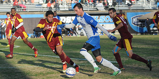 Tom Moody battles through a pair of Park defenders in the Blue Raiders' 3-1 win.