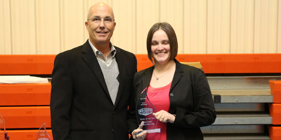 LWC coach Alicia Kemnitz (right) is presented MSC Men's Swimming Coach of the Year by MSC Commissioner Eric Ward