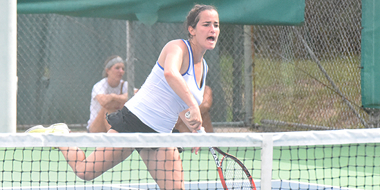 Ana Helena Pinto smashes home the decisive point to win her singles match